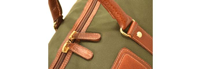 Close up of Ballistic Nylon bad with Leather strapping and hardware